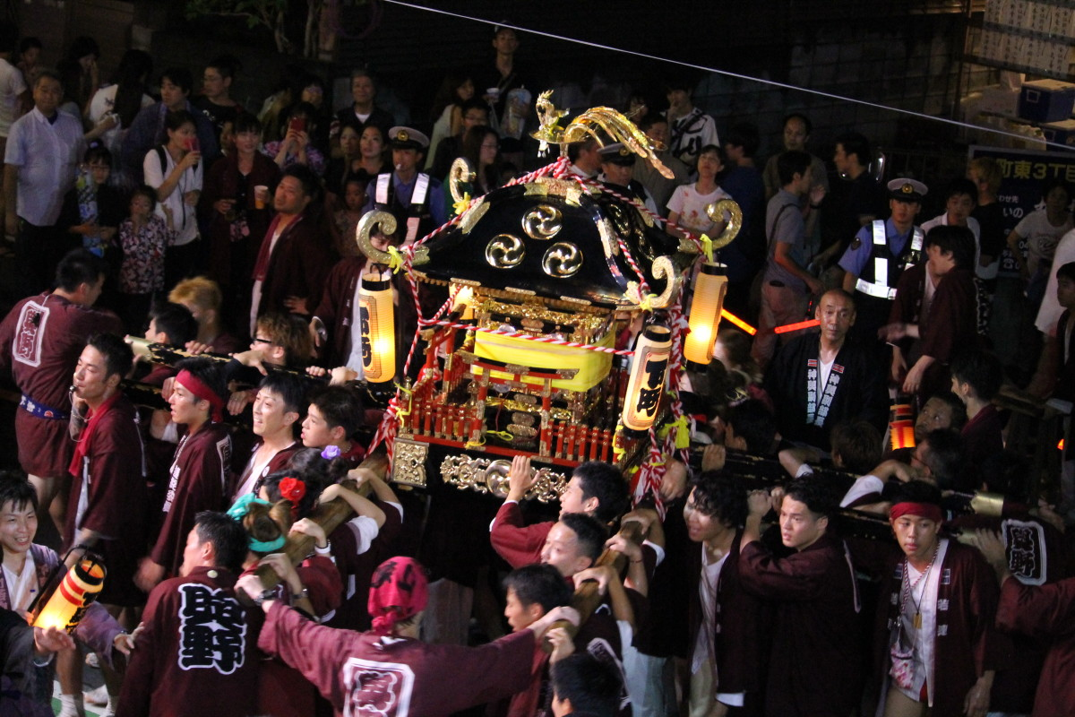 A 'mikoshi' carried on the shoulders of the locals around town.