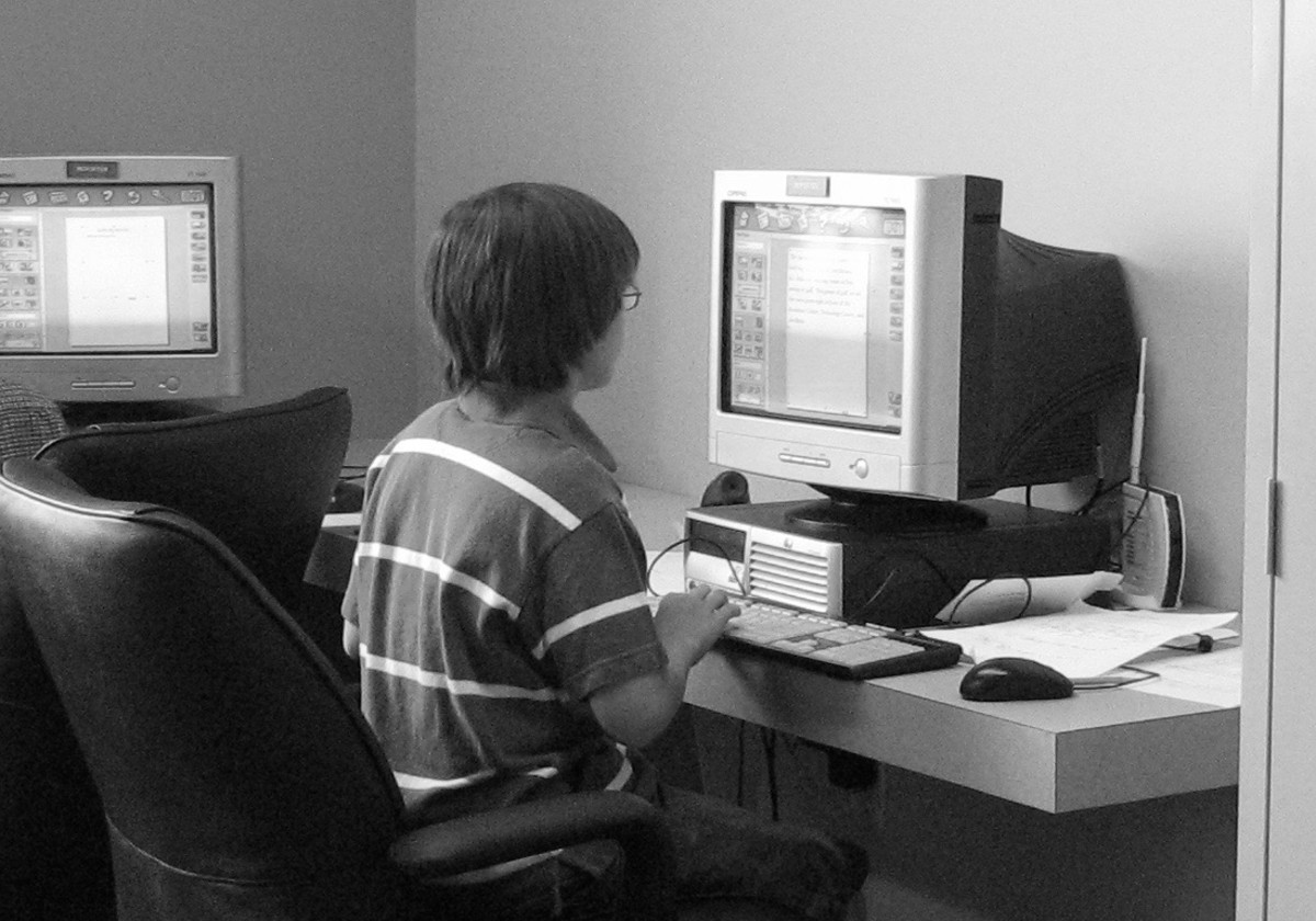 My ten year old writer working on his newspaper article on a homeschool field trip at Exchange City.