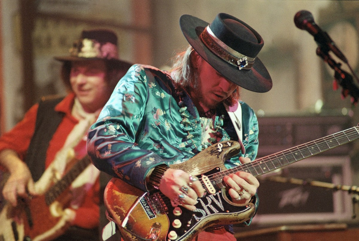 Stevie Ray Vaughan with Double Trouble. Tommy Shannon is in the back.
