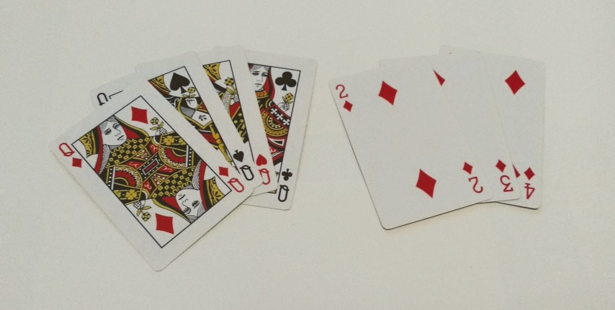 A winning hand of 4 of a kind and a run of diamonds.
