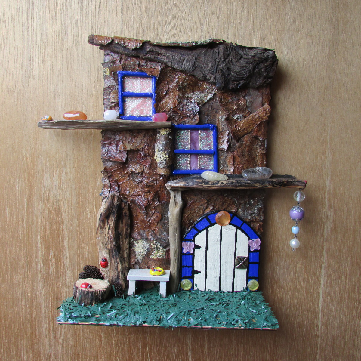 Learn how to make windows and doors for a fairy tree house.