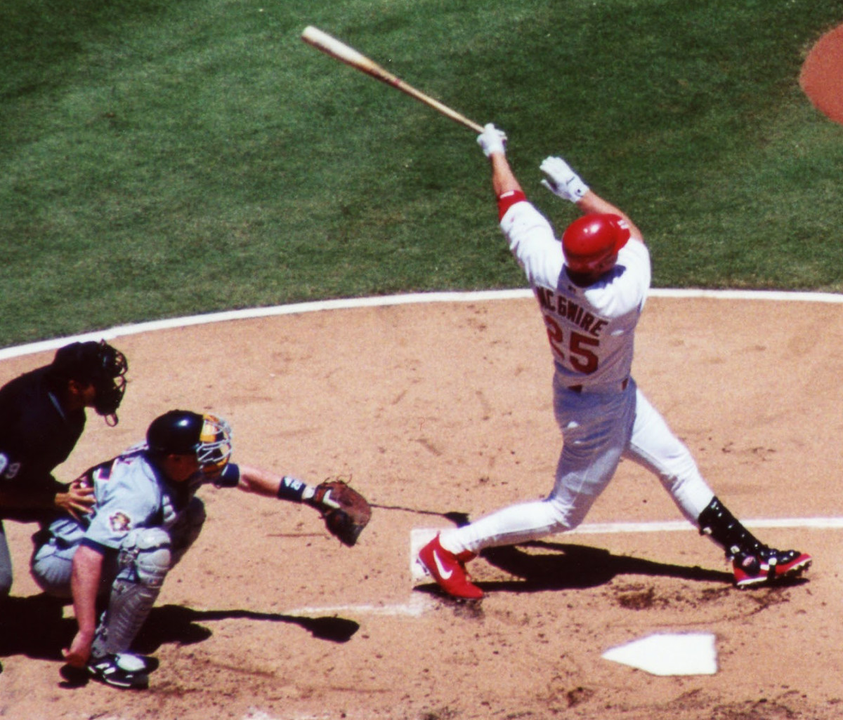 Mark McGwire is one of three players who reached the 50-homer mark four times.