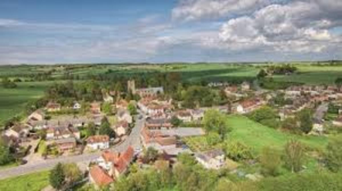 My little village of Dunmow, Essex, England...pretty but so quiet you can hear mice fart.