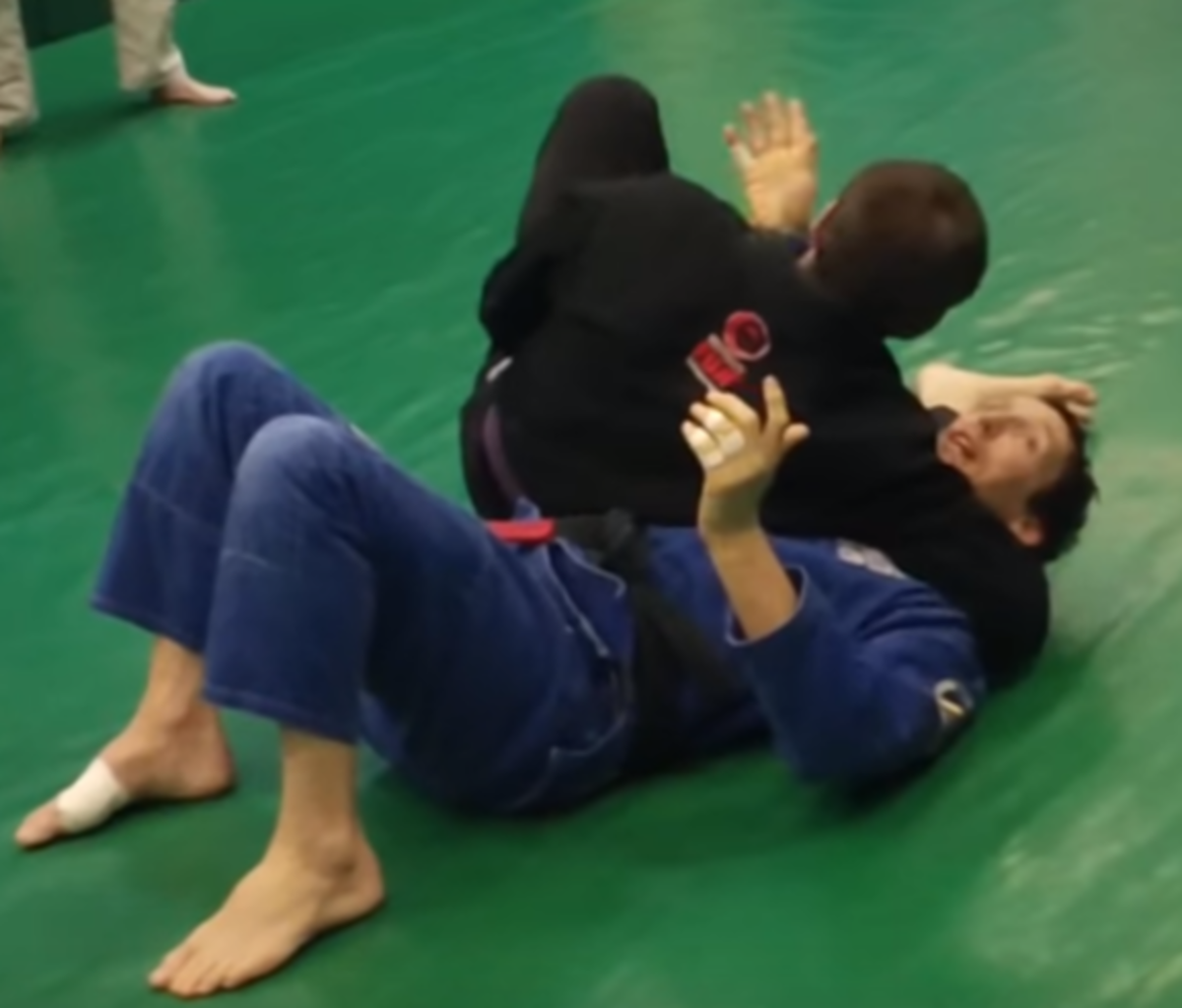 Attempting to escape a headlock.