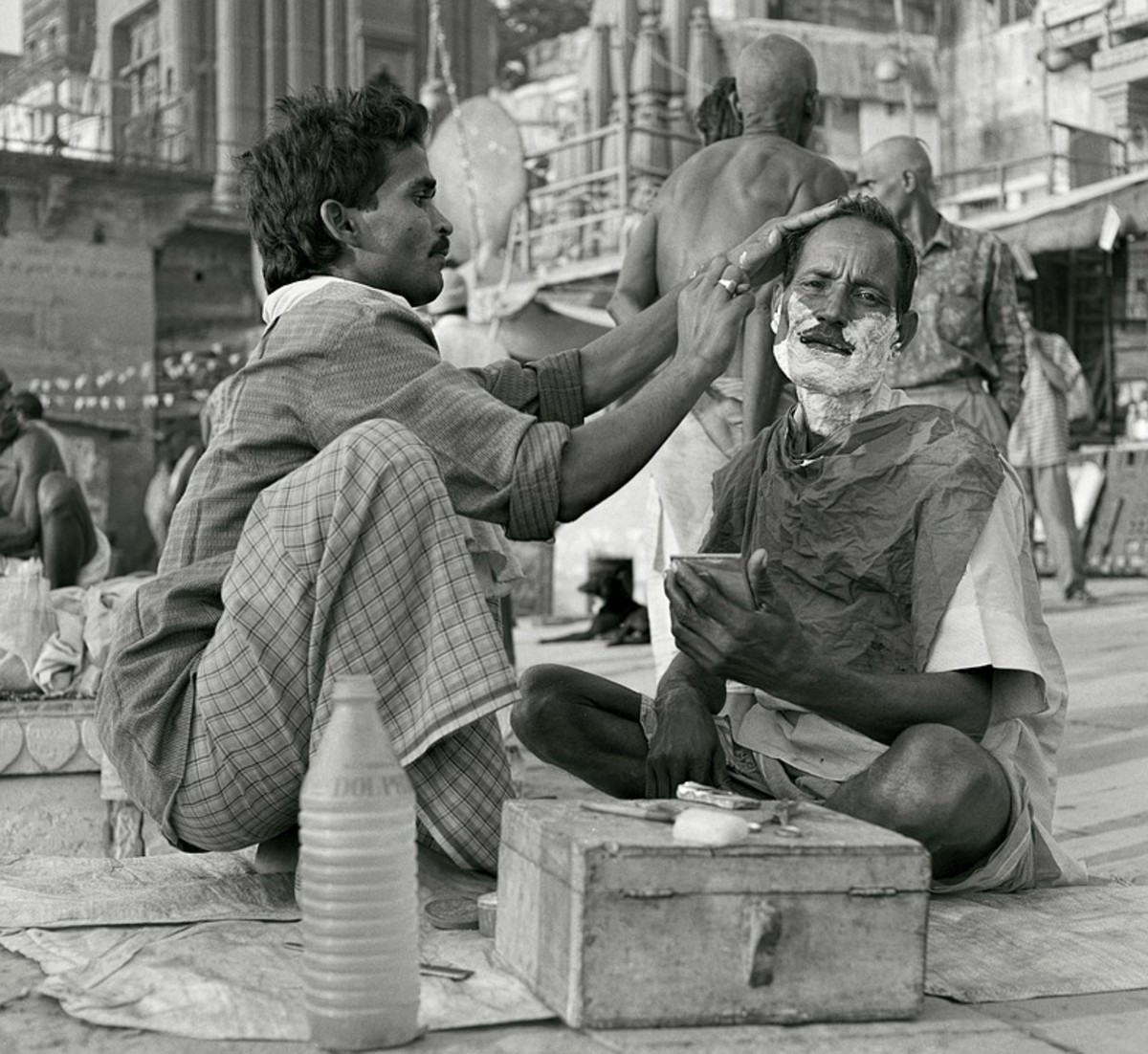 This is a man shaving another man. Teens in my day just shaved by ourselves--part of our growing up ritual in America.