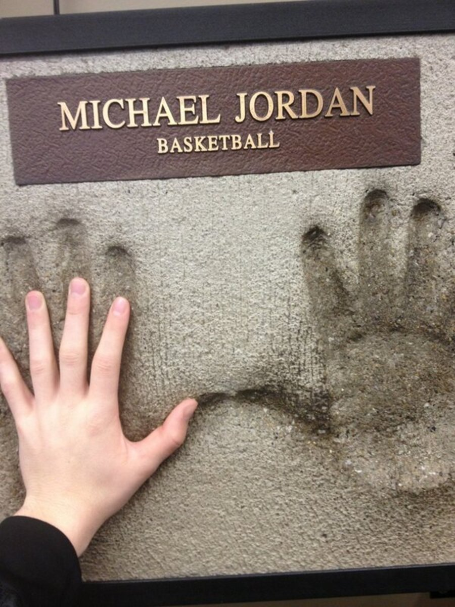 A cement impression of Michael Jordan's hands allows you to test your hand size against those of this basketball legend.