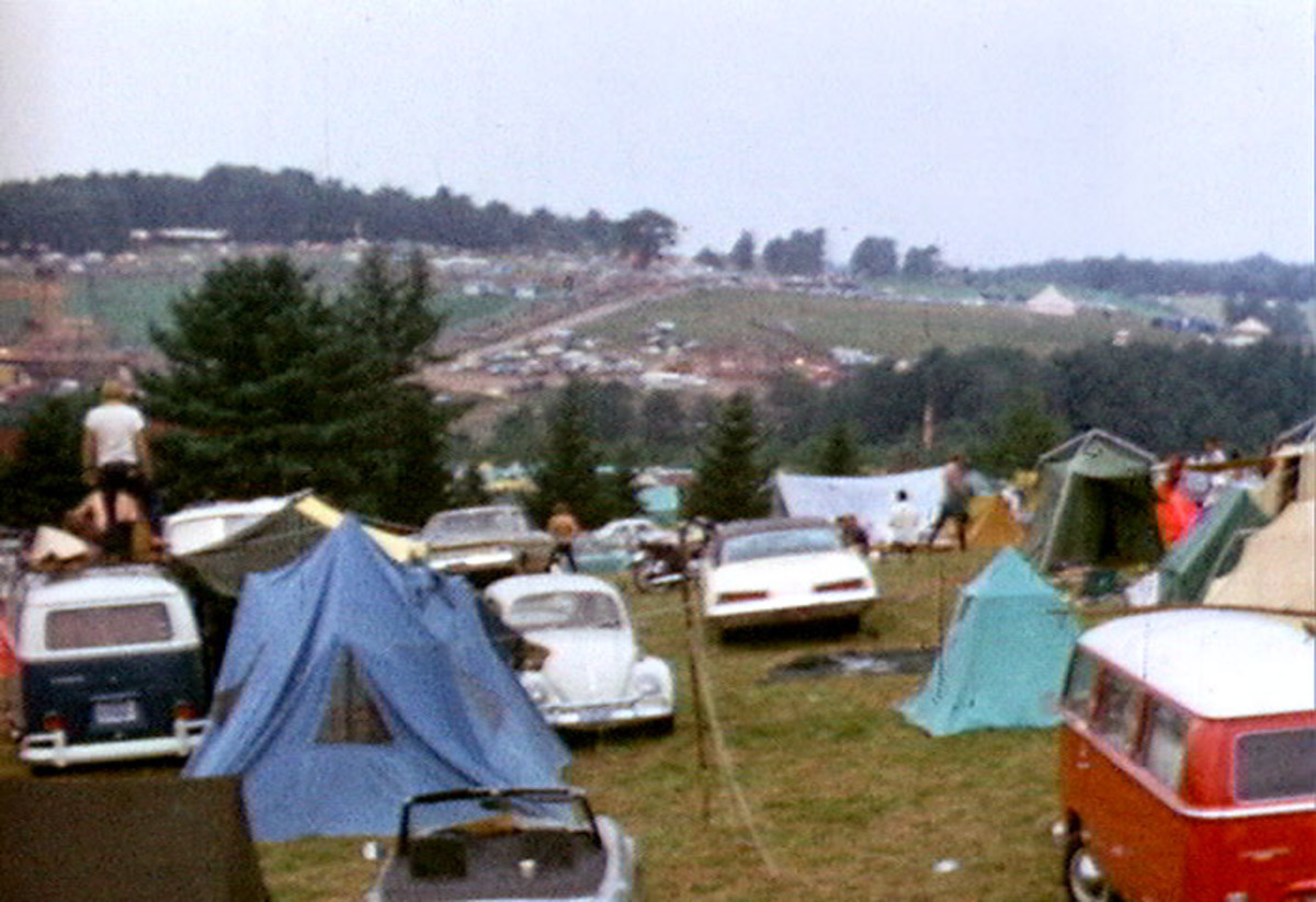 Tents and cars of spectators at Woodstock.