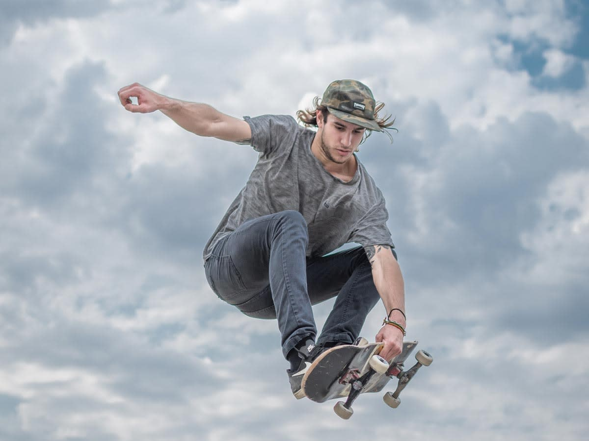 Learn more about how workwear became a fashion statement, like this skater demonstrates.