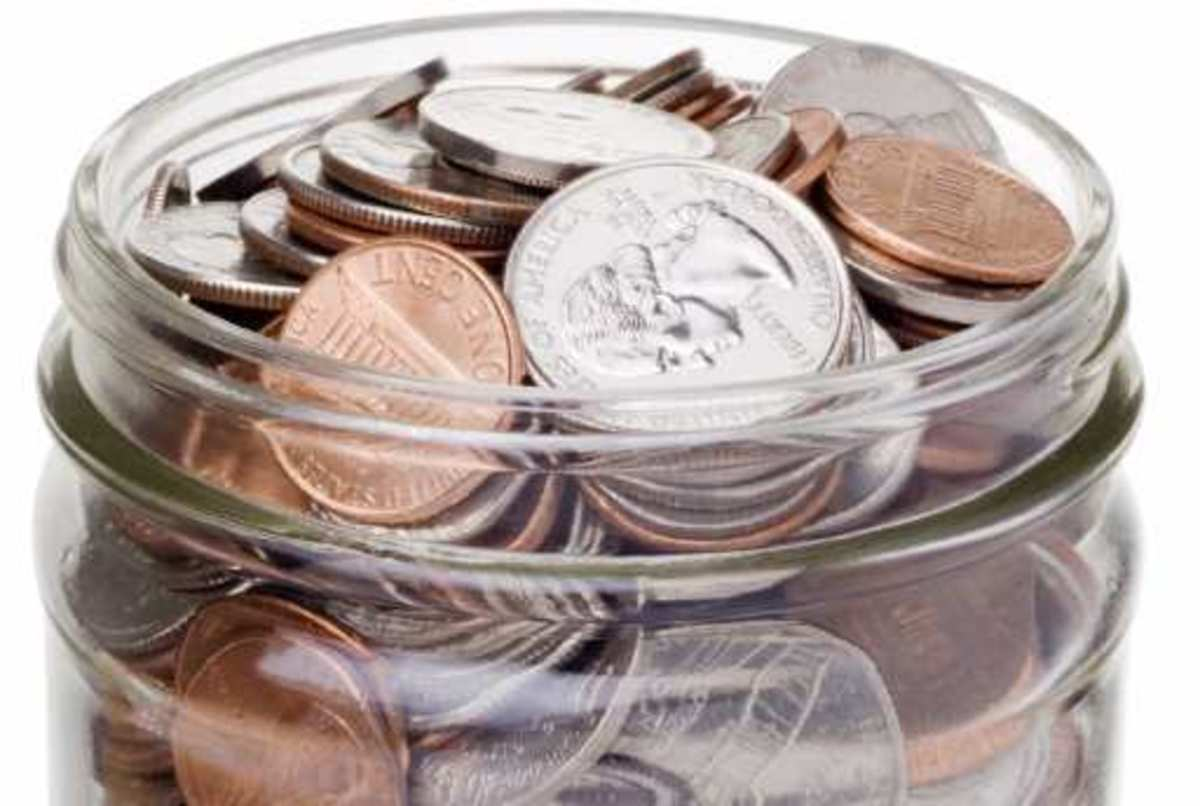 various coins in a glass jar