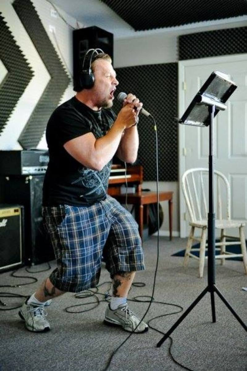 Dale Thompson of Bride records vocals in studio