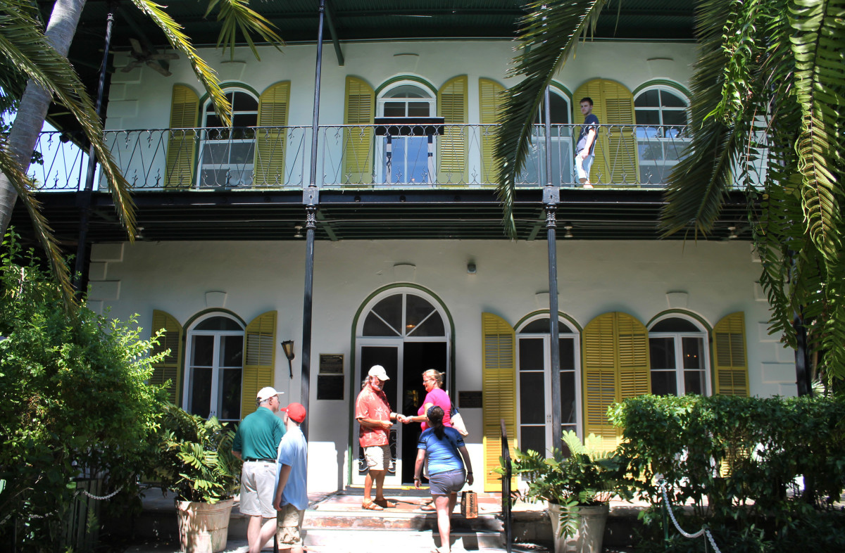 Hemingway House, Key West, Florida, USA.  Picture shows the author's wife and daughter at the entrance to Hemingway House.