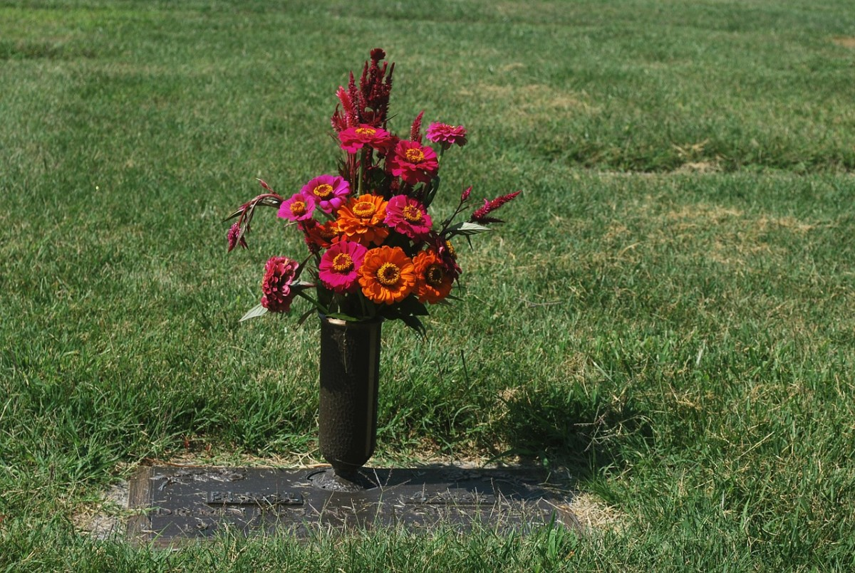 Flowers at a cemetery. The death of a spouse can gravely affect the health of the surviving spouse.