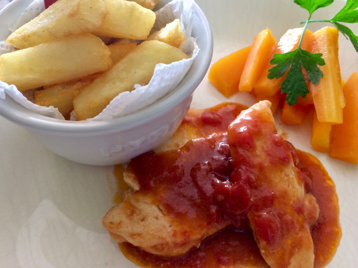 My Daughter's Lunch: Chicken fillets in a sweet tomato and black olive sauce with homemade chips and carrot sticks.