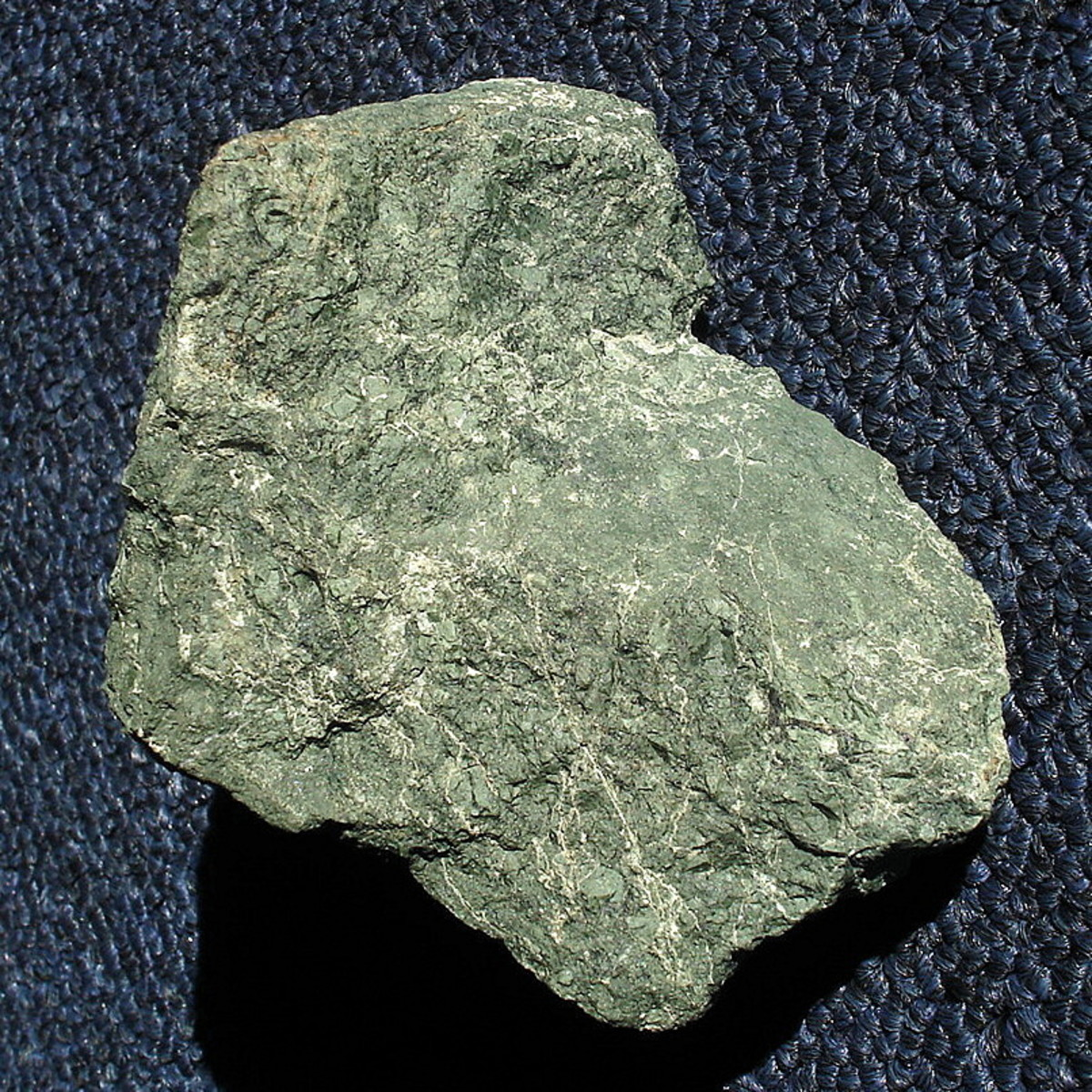 A piece of raw unpolished serpentine.