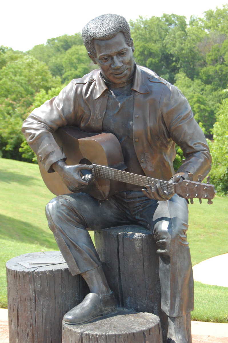 "Statue entitled ""Otis Redding Sittin on the Dock of the Bay"" in Gateway Park, Macon Georgia. Statue by Bradley Cooley and Bradley Cooley, Jr, of Bronze by Cooley."