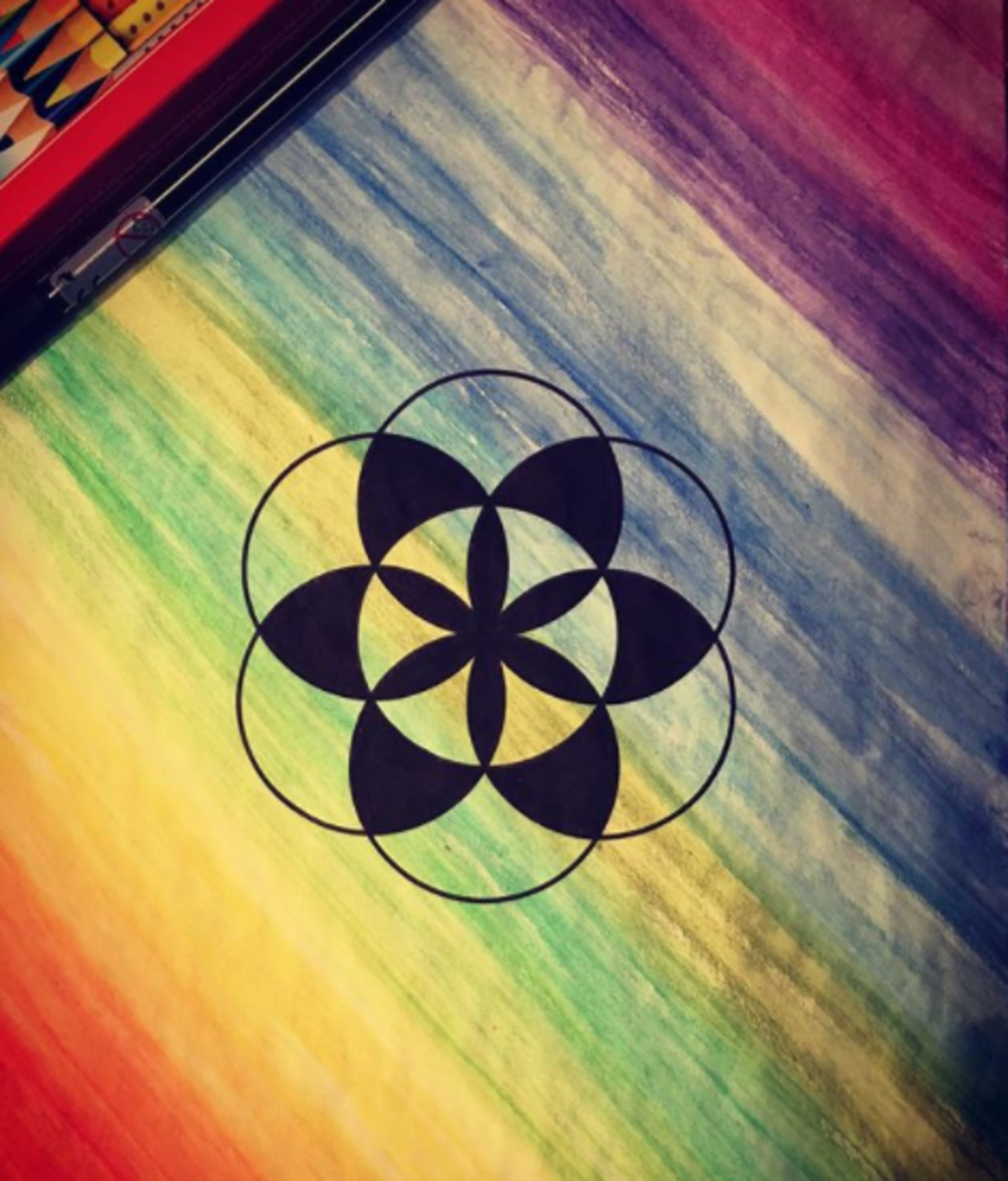The seed of life on a watercolored rainbow background