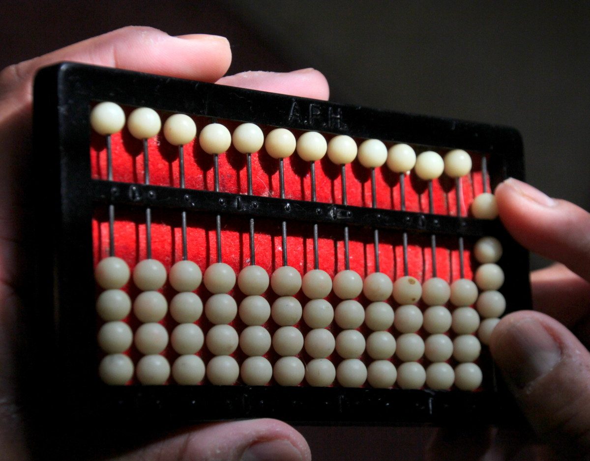 "This Abacus is showing the number ""9"": one upper4 five dot and four lower ones dots."