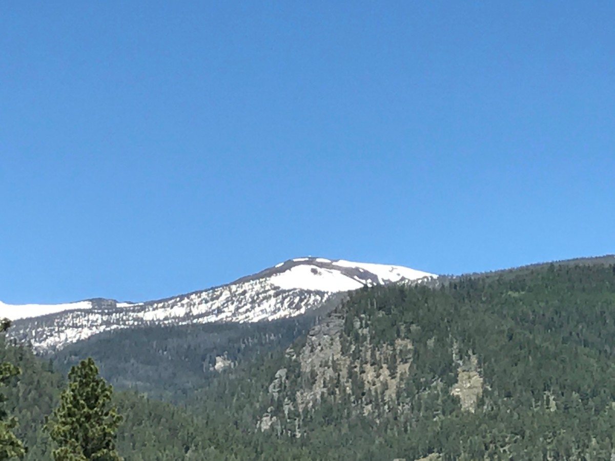 Look closely and you can see the wildfire lookout tower on the top of the snow capped peak.
