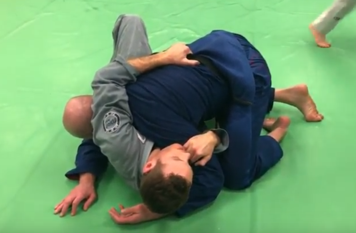 Bridge-and-Roll Escape From Side Control in Brazilian Jiu-Jitsu