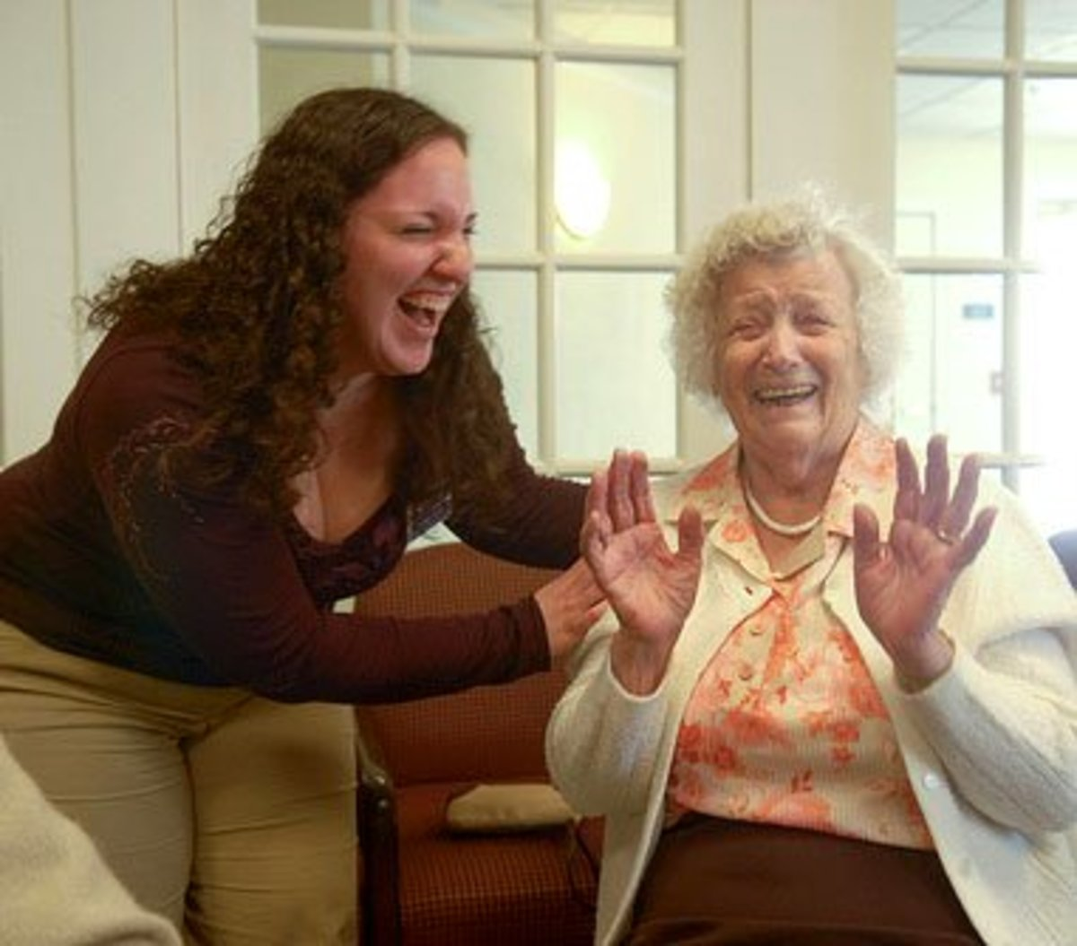 A good laugh is the best medicine. Physical therapy student Ashley Testa shares a laugh with a Legacy Senior Living resident, where she volunteers.