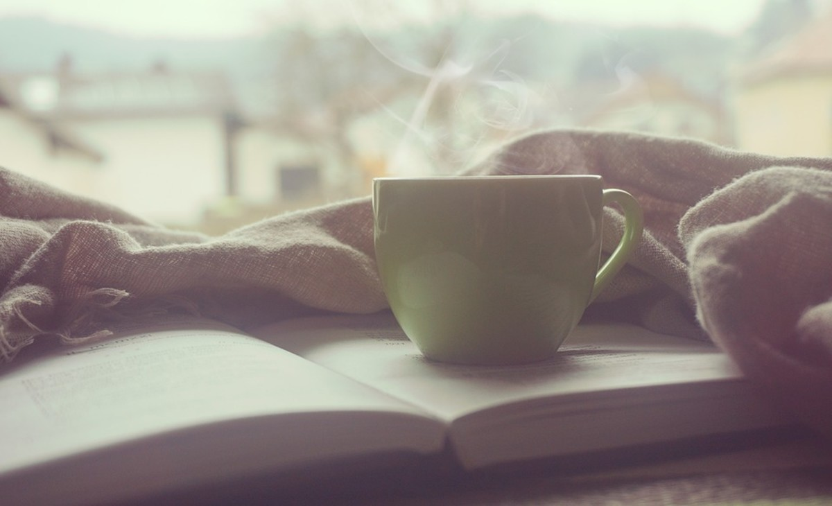 Allowing yourself to do things you enjoy, like reading a good book with a mug of hot chocolate, is one way to be kind to yourself.