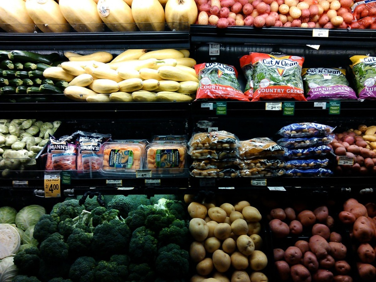 A well-stocked produce section in a large retail grocery store