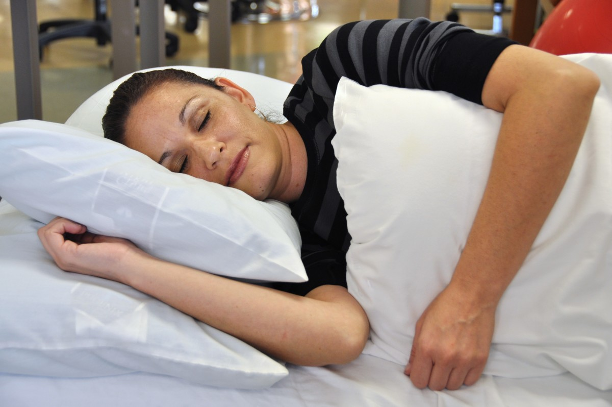If you are going to sleep on your side, stack your shoulders and hips. Rest your top arm on your side or on pillows.