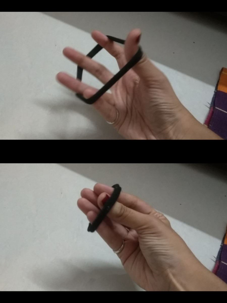 Use a hair tie or rubber band provide resistance as you slowly open your hand.