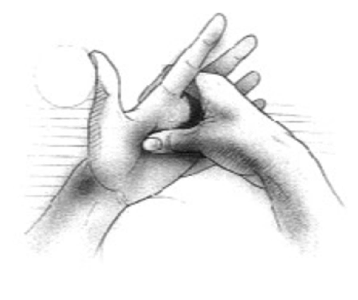 Reflexology on the hands.