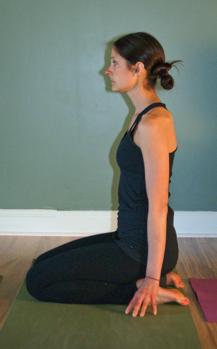 Virasana - sitting on block for extra height