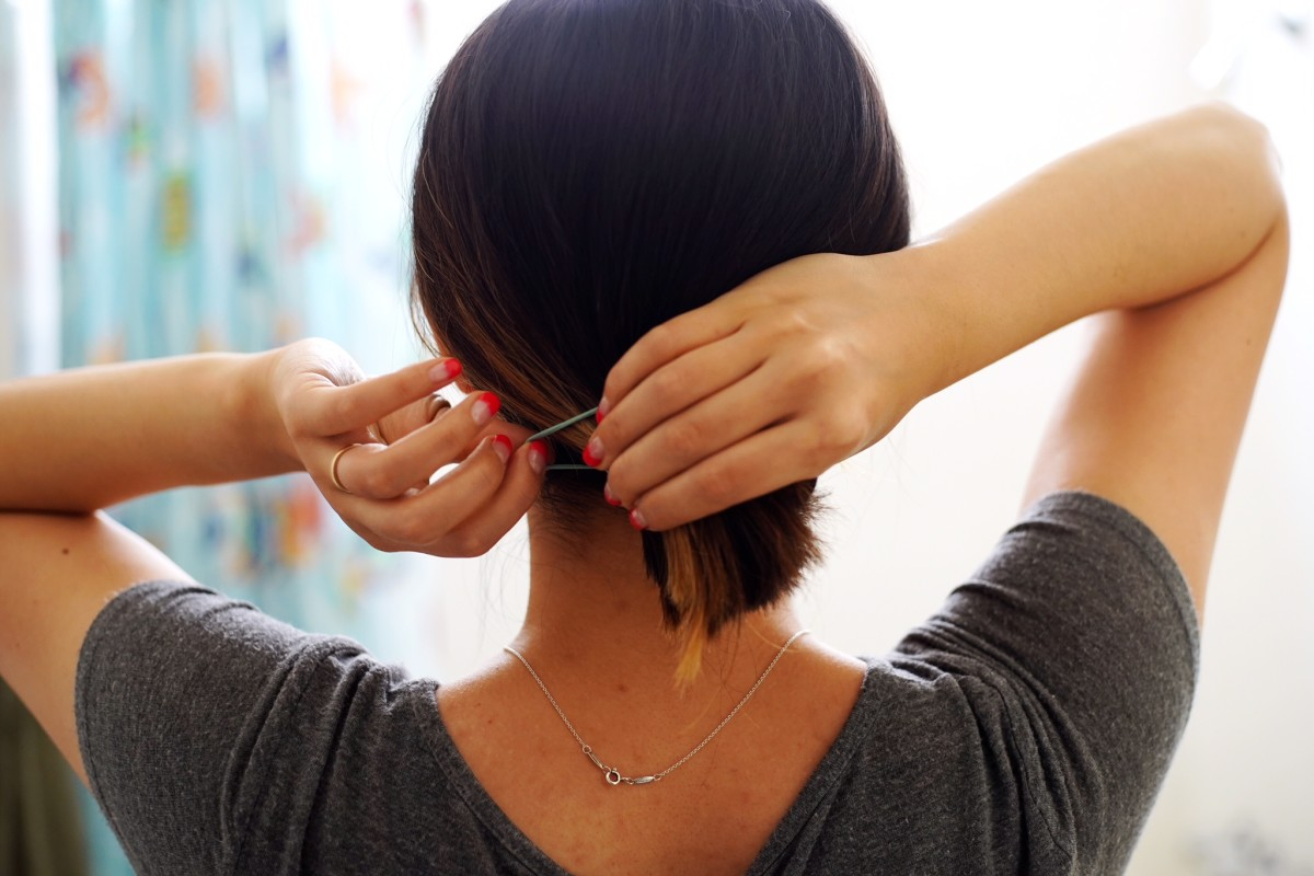 Tie your hair so it's harder for lice to crawl onto your head.