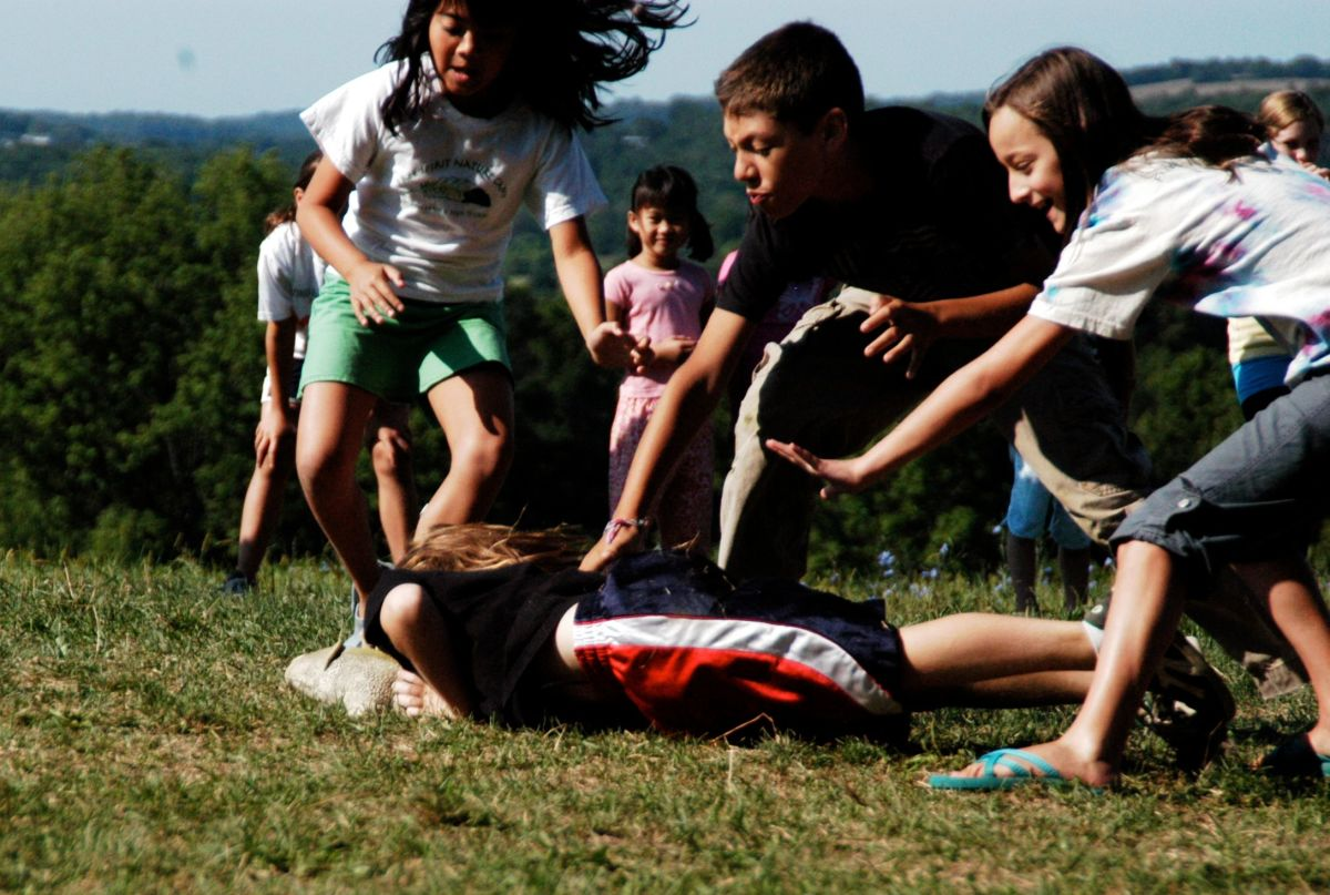 Playing closely can spread Head Lice because of the head-to-head contact.