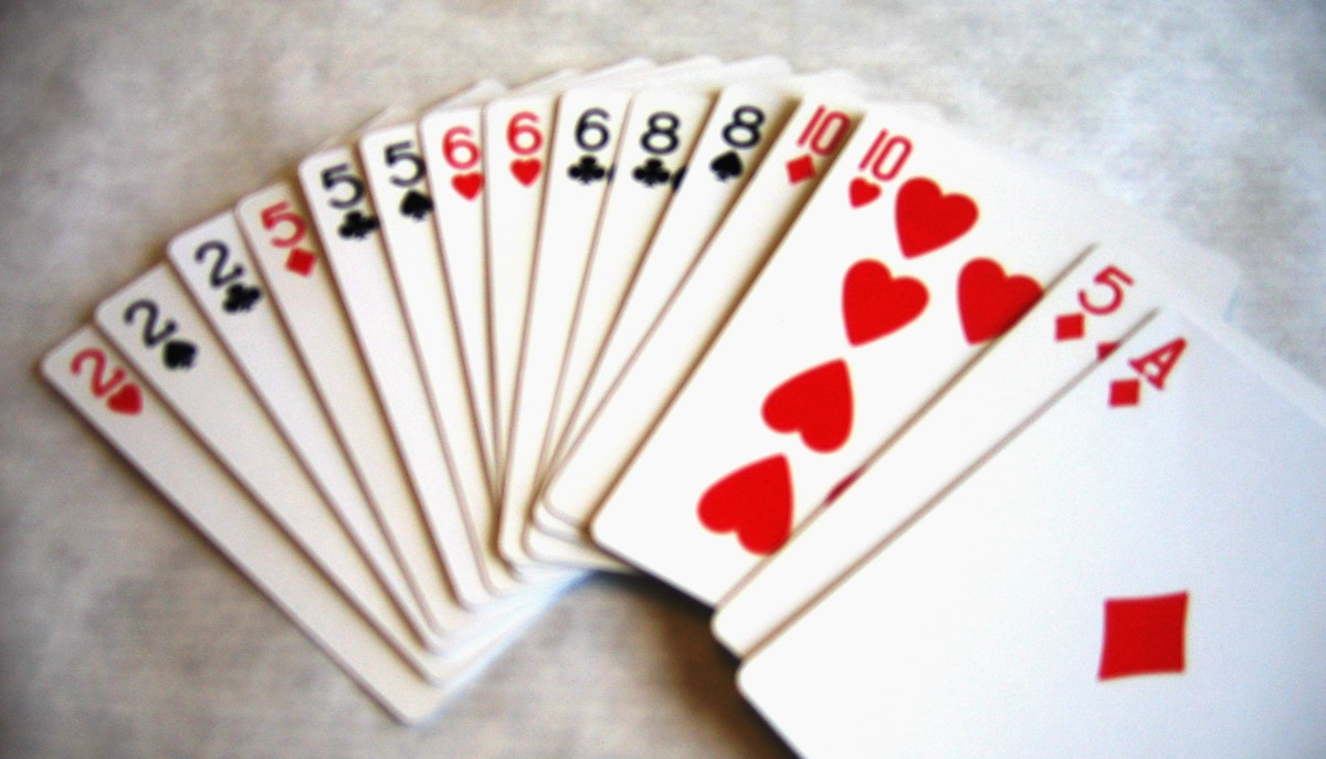 Player draws two from the deck in the center of the table. Lucky draw! Player can meld the entire front hand, and discard the ace into the pile.