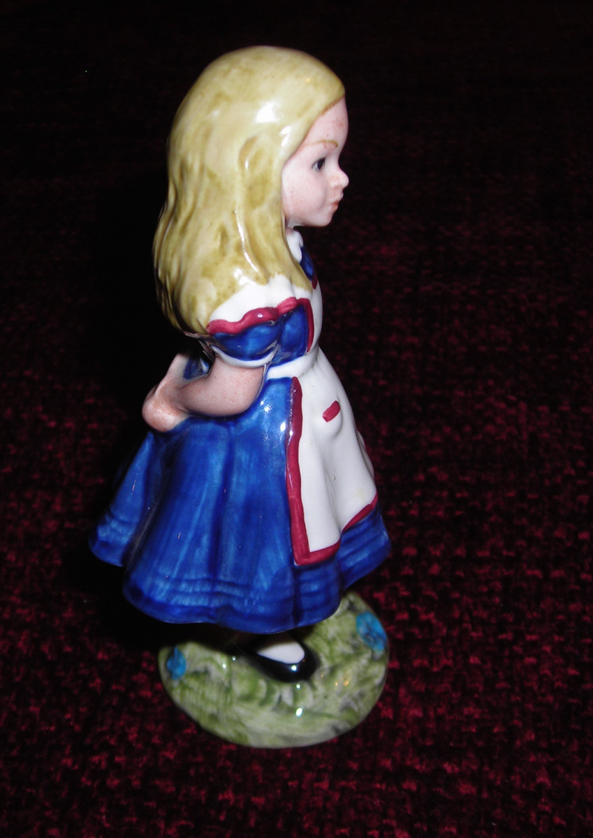 Beswick/Royal Doulton figurine of Alice in Wonderland, style one, Royal Doulton under license from Beswick