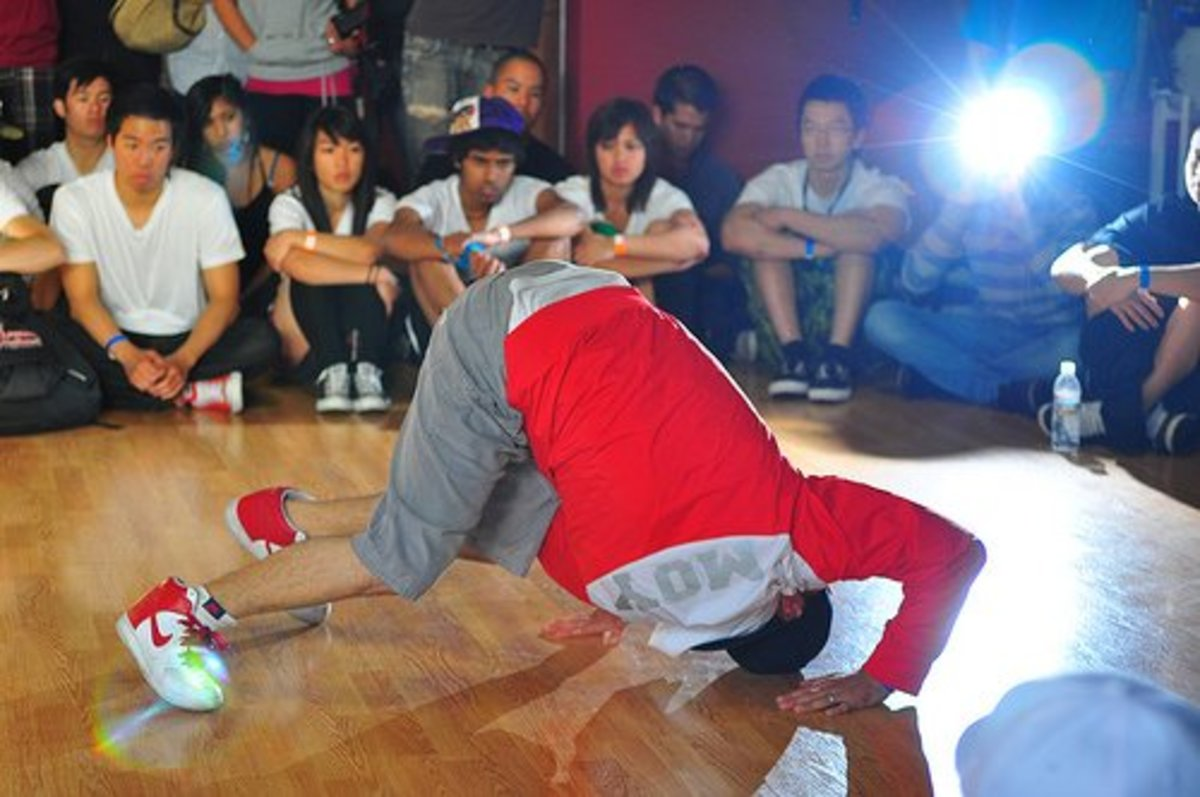 B-boys perform to an audience. Though dancers are incredibly athletic, not many people would consider dancing to be a sport.