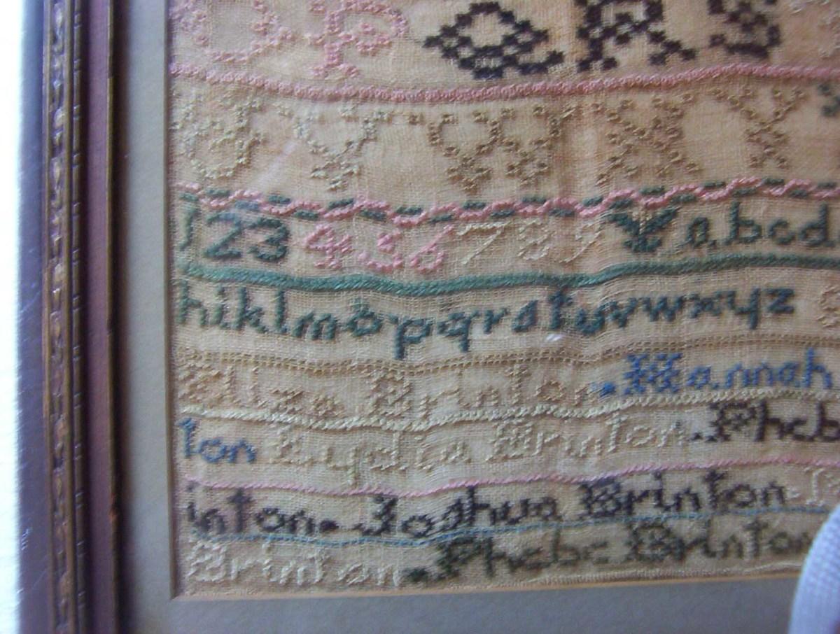 Antique sampler: Brinton Family sampler close up