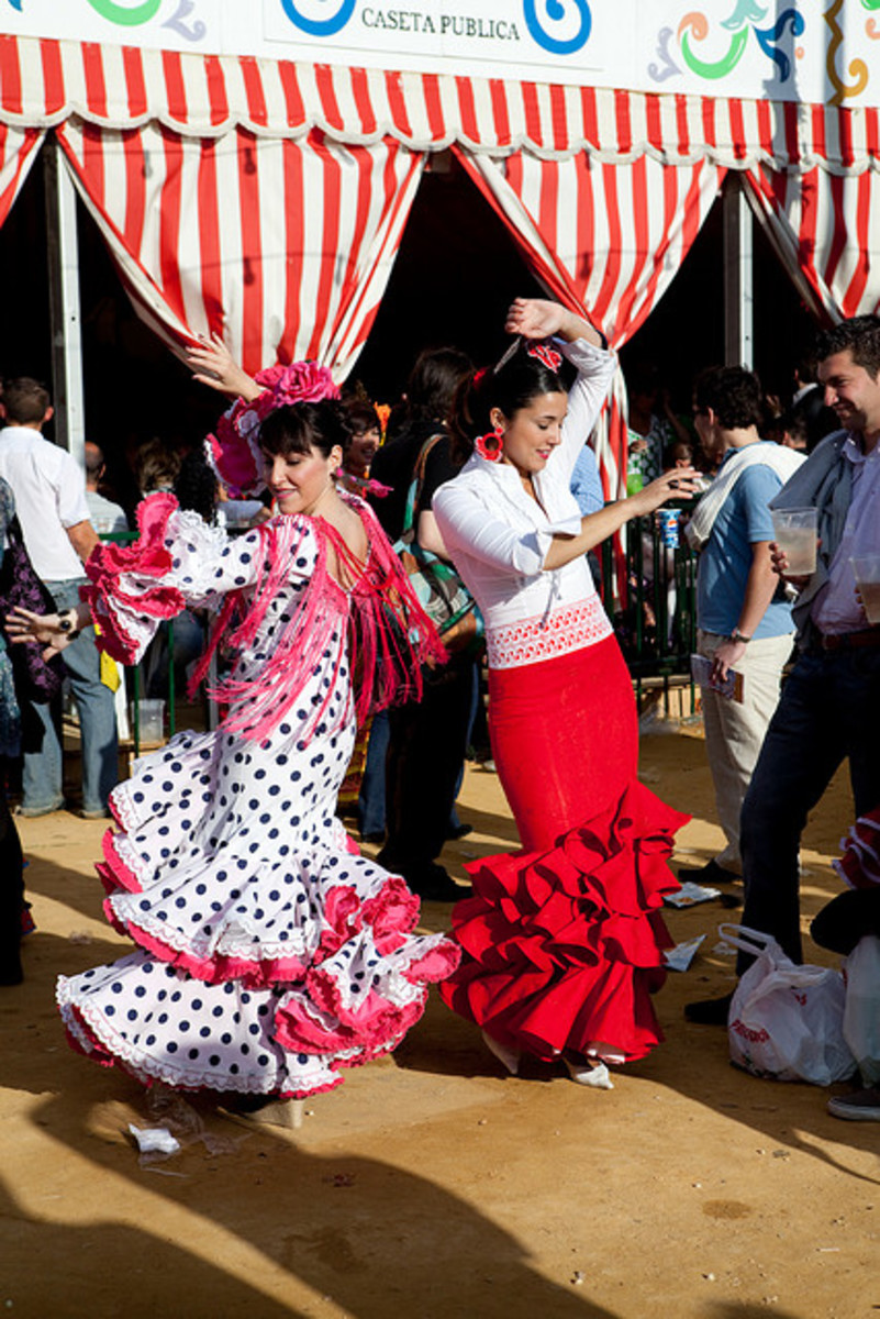 Sevillanas in traditional feria dresses