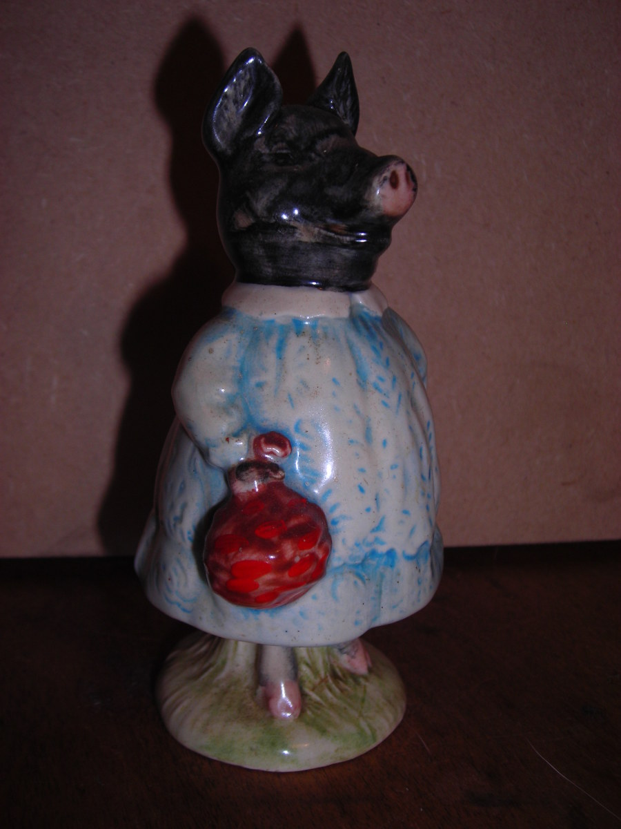 Beswick Beatrix Potter Pig-Wig BP 3b—Black Pig With Blue Dress.