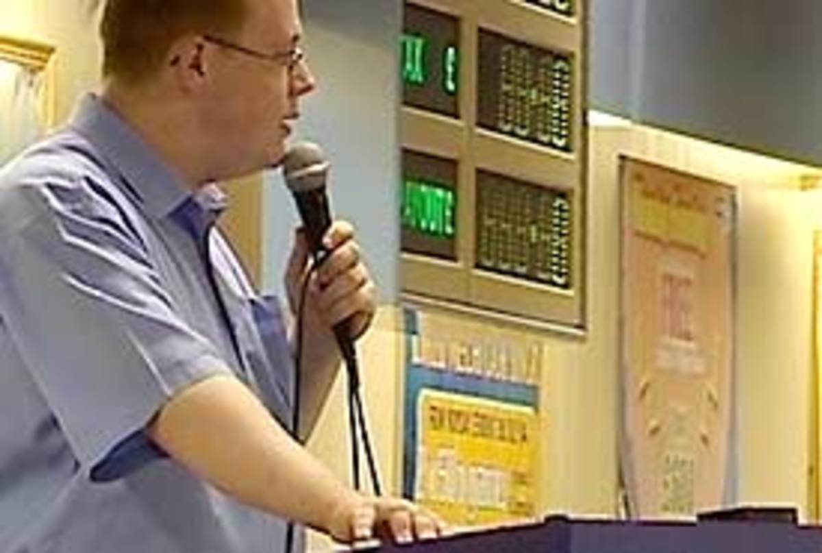This is a bingo caller in a professional hall. You don't need to be this good, but you can learn a lot from them should you ever need to call a game of bingo.