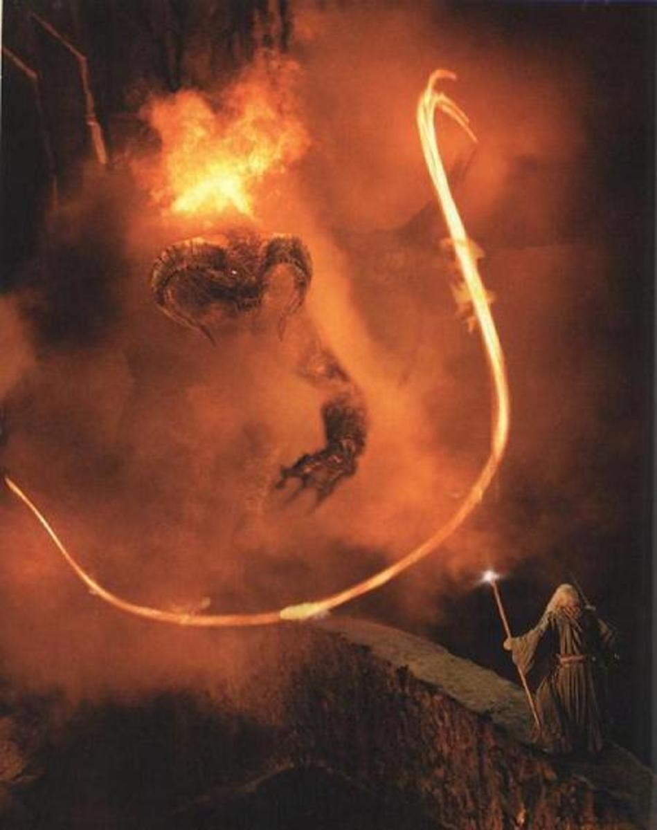 Gandalf fights the Balrog to save his friends.