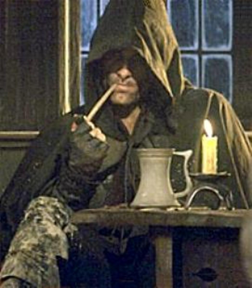 Aragorn the Ranger smokes a pipe at Inn of the Prancing Pony in Bree.