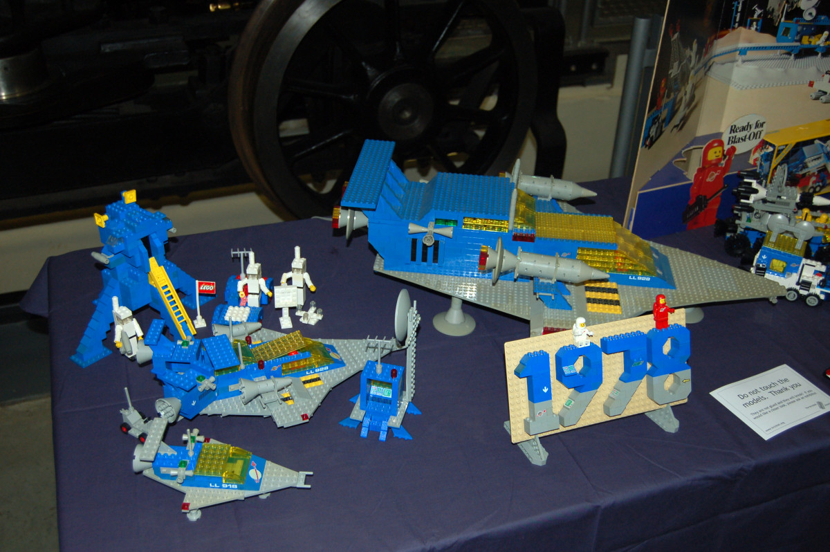The moon landing set on the left is circa 1975, and is an extremely early example of the Lego Space series.