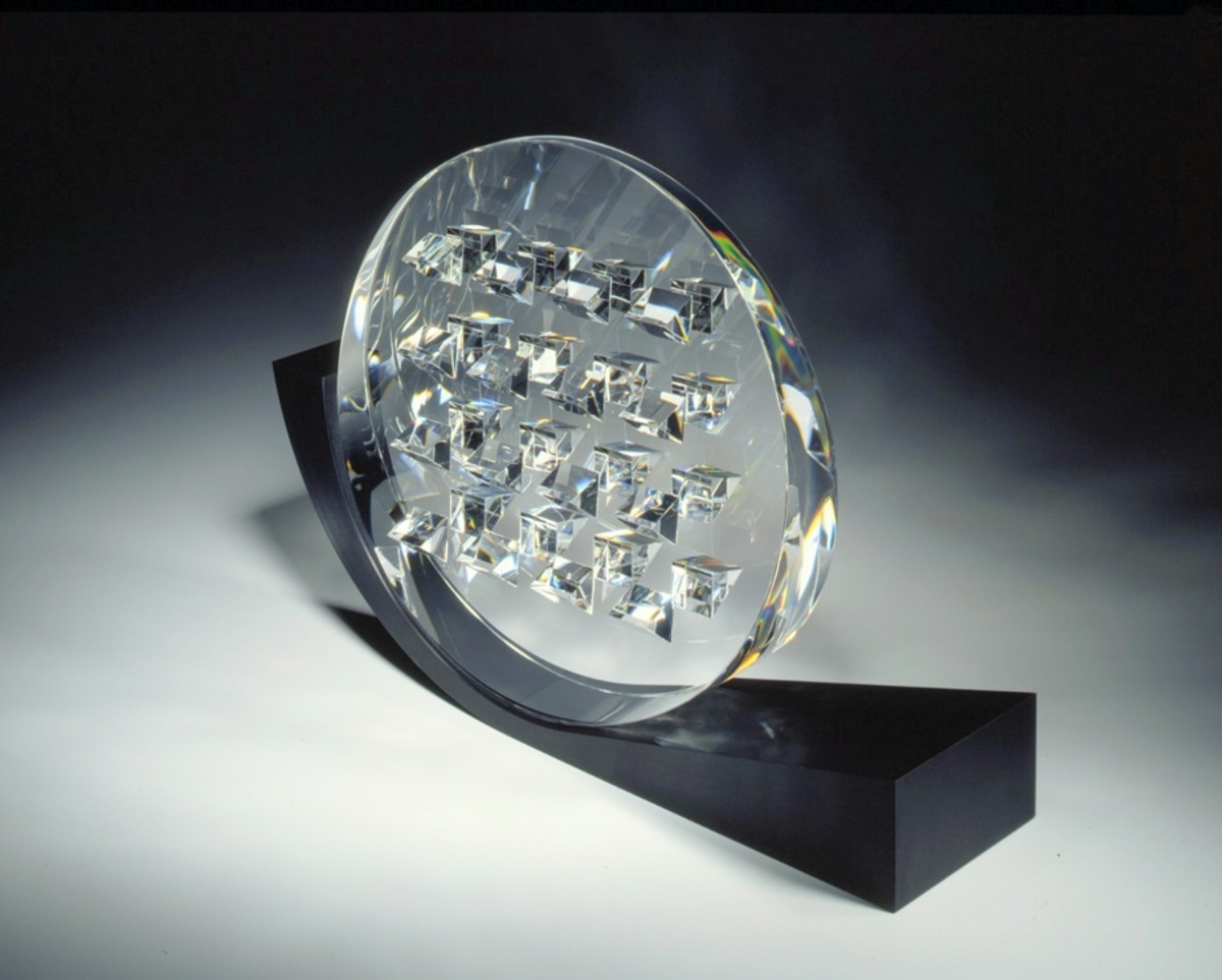 Steuben produced colorless crystal from 1933–2011, as exemplified by this crystal award statue it designed for the Foundation Fighting Blindness.