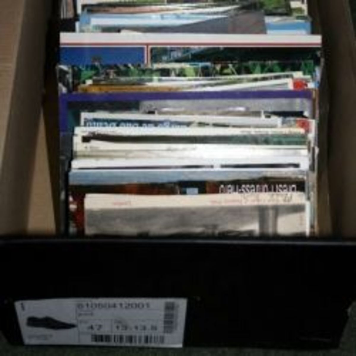 Shoe box filled with postcards