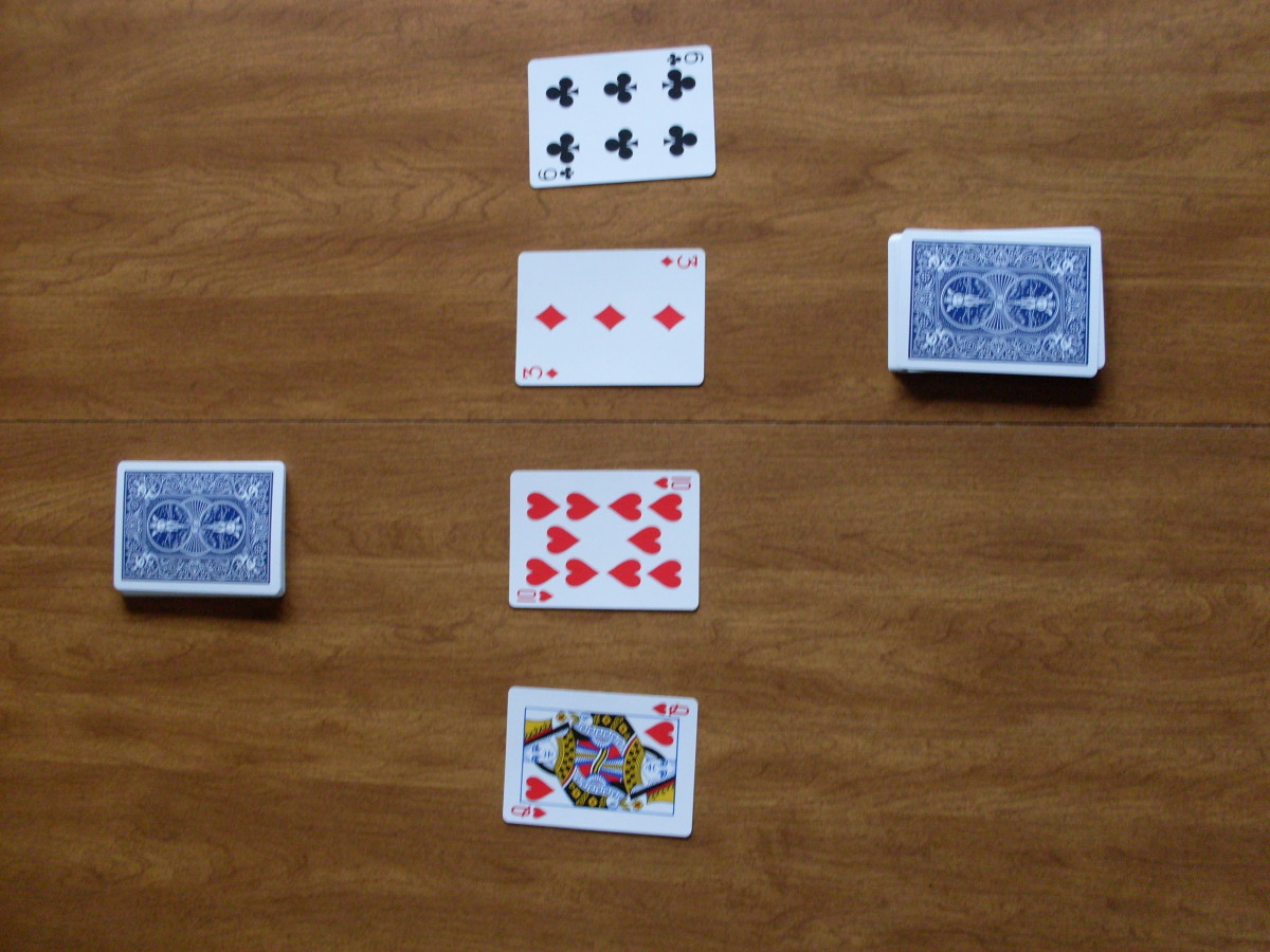 Here you see how the game should look before anyone has taken a turn. There are two draw piles with four cards in the center.
