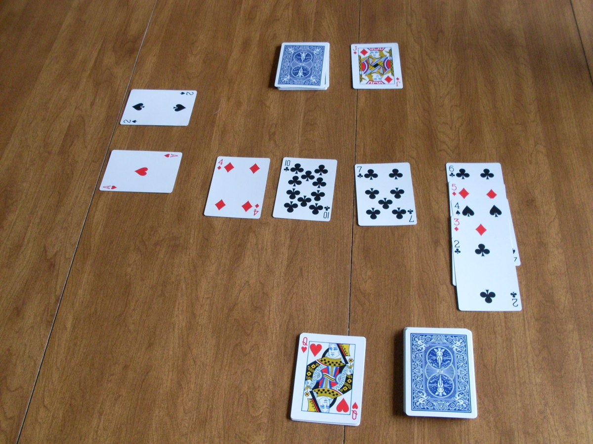 This is what your cards will look like once the play has been going on for awhile. Notice there are aces being built on in the left hand side.