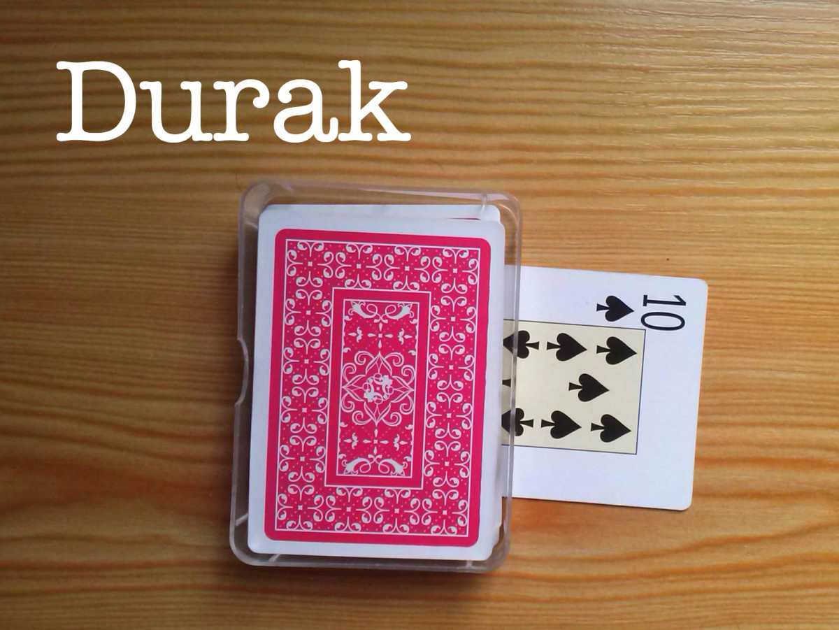 The setup of Durak. This is the talon. The 10 of clubs determines the trump suit. Each player should have six cards in hand.