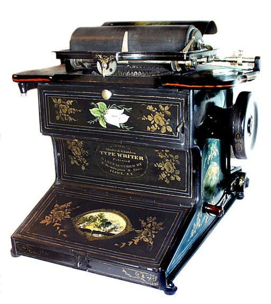 Sholes & Glidden Type-Writer, invented by Christopher Latham Sholes, Carlos Glidden, and Samuel W. Soule in 1868, and manufactured by Remington & Sons, Ilion, New York, USA, between 1874 and 1878.