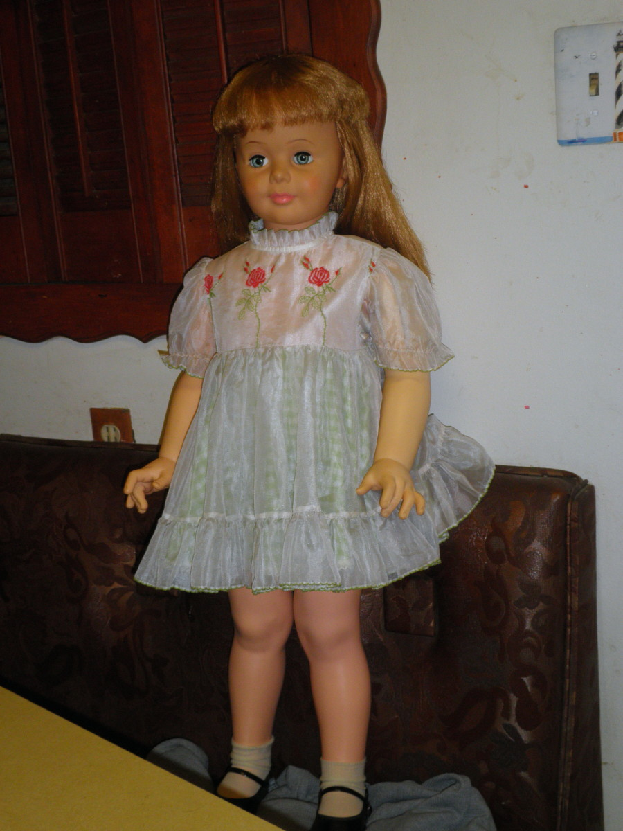 Patty Playpal doll with a size 3 dress from the 1950s - 1960s. Many of these dolls were dressed up in real toddler clothes from the that period.