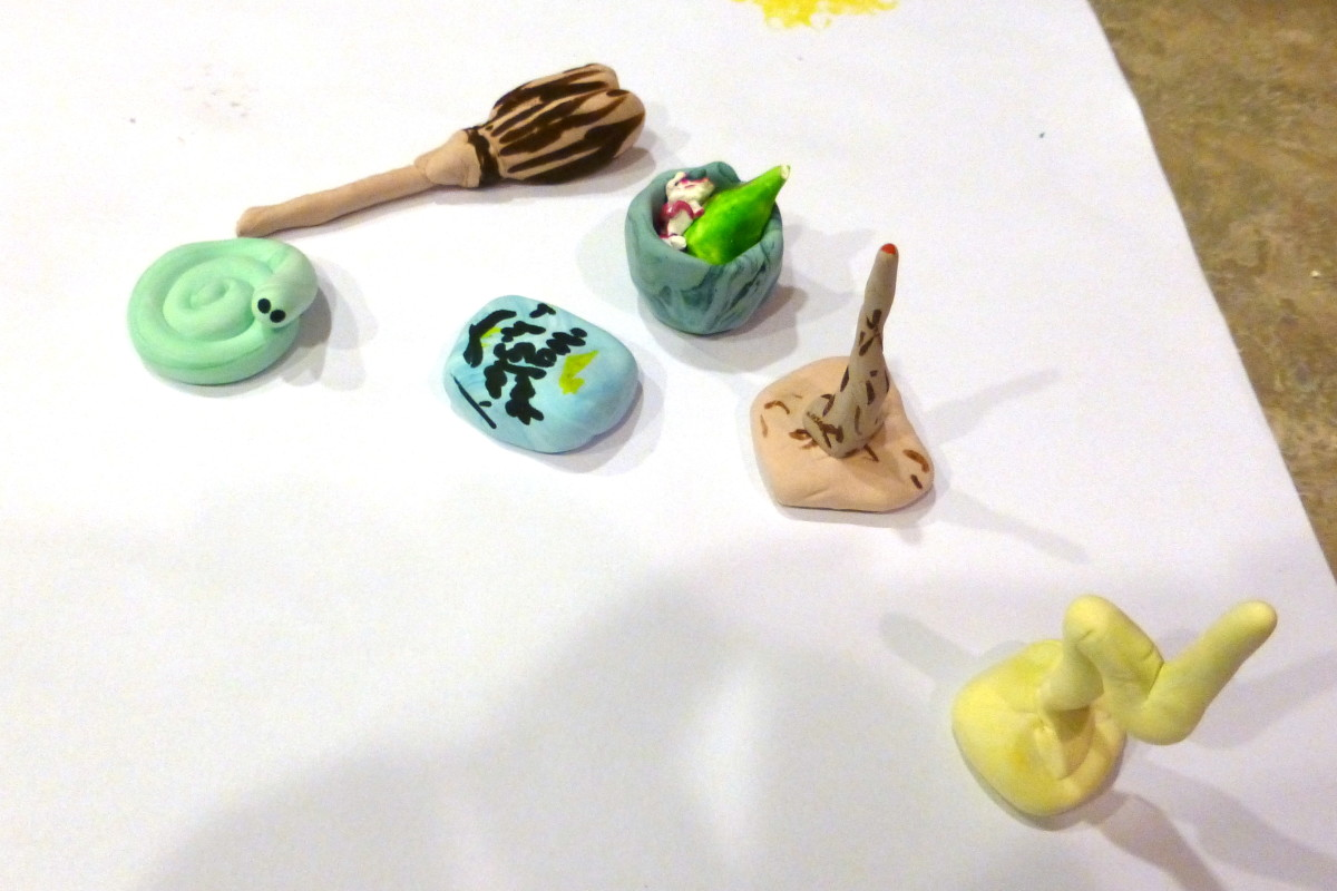 Our game pieces are all magic-themed: a snake, a broom, a book, a cauldron, a wand, and a lightning bolt.